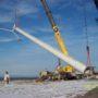 Cranes lifting wind turbine